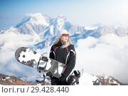 Купить «Young adult woman snowboarder holding snow board», фото № 29428440, снято 18 марта 2018 г. (c) katalinks / Фотобанк Лори