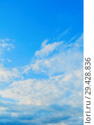 Купить «Blue sky background with dramatic colorful fluffy clouds and sunlight. Beautiful sky landscape», фото № 29428836, снято 27 апреля 2018 г. (c) Зезелина Марина / Фотобанк Лори