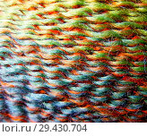 Купить «Skein of wool yarn. Macro shooting. Texture of wavy thread. Bright rainbow multicolor threads. Background image. Hobbies, leisure, crafts.», фото № 29430704, снято 5 сентября 2018 г. (c) Юлия Фаранчук / Фотобанк Лори