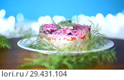Layered salad of boiled vegetables with beets and herring. Стоковое видео, видеограф Peredniankina / Фотобанк Лори