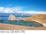 Купить «Baikal Lake in sunny May day. View of the natural landmark - Shamanka Rock from the coast of Olkhon Island during ice drift», фото № 29431176, снято 22 мая 2011 г. (c) Виктория Катьянова / Фотобанк Лори