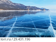 Купить «Lake Baikal in winter. View from the ice on the Sandy Bay (Peschanaya Bay) and the rocks of the Big and Small Belltower (Kolokolny)», фото № 29431196, снято 2 марта 2013 г. (c) Виктория Катьянова / Фотобанк Лори