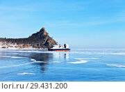Купить «Lake Baikal in winter. The hovercraft Khivus brought tourists on the ice to the camp site in the famous Sandy Bay (Peschanaya Bay) for the winter holidays», фото № 29431200, снято 2 марта 2013 г. (c) Виктория Катьянова / Фотобанк Лори