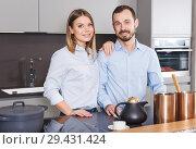 Купить «Loving couple in kitchen», фото № 29431424, снято 24 мая 2018 г. (c) Яков Филимонов / Фотобанк Лори
