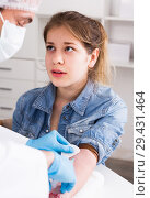 Купить «Doctor injecting teenage girl», фото № 29431464, снято 4 марта 2017 г. (c) Яков Филимонов / Фотобанк Лори