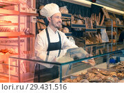 Купить «Good male pastry maker demonstrating croissant», фото № 29431516, снято 26 января 2017 г. (c) Яков Филимонов / Фотобанк Лори