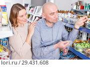 Купить «pair picking different candies», фото № 29431608, снято 11 апреля 2018 г. (c) Яков Филимонов / Фотобанк Лори