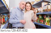 Купить «Portrait of smiling couple near shelves with pickle goods», фото № 29431632, снято 11 апреля 2018 г. (c) Яков Филимонов / Фотобанк Лори