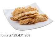 Купить «Chicken strips in sesame with sauce», фото № 29431808, снято 17 декабря 2018 г. (c) Яков Филимонов / Фотобанк Лори