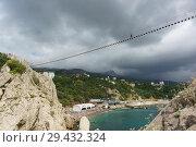 Купить «Смелая девушка идет по веревочному мосту между скалами Дива и ПАнеа высоко в облаках. Пасмурный летний день», фото № 29432324, снято 9 сентября 2018 г. (c) Наталья Гармашева / Фотобанк Лори