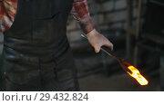 Купить «Getting the detail out of a furnace and putting it under the huge pressure of automatic sledgehammer», видеоролик № 29432824, снято 21 ноября 2018 г. (c) Константин Шишкин / Фотобанк Лори