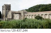 Купить «Historical view of Castle of Abbey Sainte-Marie d'Orbieu in Lagrasse, France», видеоролик № 29437244, снято 27 октября 2018 г. (c) Яков Филимонов / Фотобанк Лори