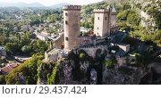 Купить «Aerial view of impressive medieval castle on rocky outcrop in French commune of Foix», видеоролик № 29437424, снято 6 октября 2018 г. (c) Яков Филимонов / Фотобанк Лори