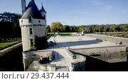 Купить «View of Tour de Marques of medieval Chateau de Chenonceau on Cher River, France», видеоролик № 29437444, снято 8 октября 2018 г. (c) Яков Филимонов / Фотобанк Лори