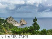 Купить «Пейзажный вид на прибрежные скалы Панеа и Дива, вдающиеся  в спокойное Черное море. На переднем плане растут сосны и можжевельники», фото № 29437948, снято 9 сентября 2018 г. (c) Наталья Гармашева / Фотобанк Лори