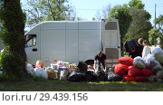 Купить «Mobile receiving point of waste recycling. environmental movement RAZdelniy sbor», видеоролик № 29439156, снято 2 июня 2018 г. (c) Ирина Мойсеева / Фотобанк Лори