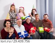 Купить «Cheerful family making numerous photos», фото № 29439756, снято 27 мая 2019 г. (c) Яков Филимонов / Фотобанк Лори