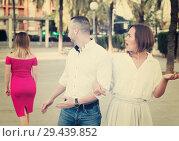 Купить «Angry female is jealousying because her boyfriend is staring on stranger girl», фото № 29439852, снято 18 октября 2017 г. (c) Яков Филимонов / Фотобанк Лори