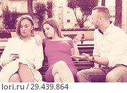 Купить «Girlfriends are rejecting stranger man who wants acquintance with them», фото № 29439864, снято 18 октября 2017 г. (c) Яков Филимонов / Фотобанк Лори