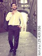 Купить «Man in formalwear walking along street», фото № 29439936, снято 5 августа 2017 г. (c) Яков Филимонов / Фотобанк Лори