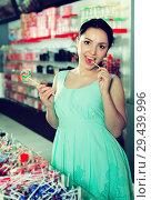 Купить «Woman posing to photographer with lollypop», фото № 29439996, снято 25 апреля 2017 г. (c) Яков Филимонов / Фотобанк Лори