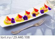 Купить «Tasty seafood ceviche from salmon with figs, kiwi and cumquat at plate», фото № 29440108, снято 25 августа 2019 г. (c) Яков Филимонов / Фотобанк Лори
