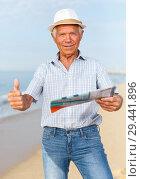 Купить «Satisfied ordinary mature man giving thumbs up», фото № 29441896, снято 16 июня 2018 г. (c) Яков Филимонов / Фотобанк Лори