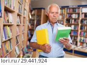 Купить «Older man choosing books in bookstore», фото № 29441924, снято 11 июня 2018 г. (c) Яков Филимонов / Фотобанк Лори