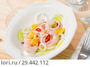 Купить «Ceviche with shrimps, lime, tangerine and hot pepper», фото № 29442112, снято 14 октября 2019 г. (c) Яков Филимонов / Фотобанк Лори