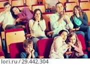 Group of people watching scary movie. Стоковое фото, фотограф Яков Филимонов / Фотобанк Лори