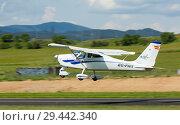 Купить «Light aircraft landing on runway», фото № 29442340, снято 20 мая 2018 г. (c) Яков Филимонов / Фотобанк Лори