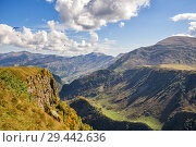 Купить «Paragliders fly over beautiful gorge in Caucasus on sunny autumn day, Georgia», фото № 29442636, снято 24 сентября 2018 г. (c) Юлия Бабкина / Фотобанк Лори