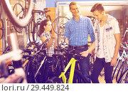 Купить «father with son and female seller in bike store», фото № 29449824, снято 27 сентября 2016 г. (c) Яков Филимонов / Фотобанк Лори