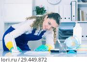 Купить «Cheerful female cleaning furniture», фото № 29449872, снято 11 апреля 2017 г. (c) Яков Филимонов / Фотобанк Лори