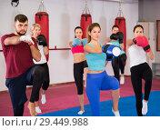 Купить «women and their trainer are boxing in gym», фото № 29449988, снято 8 октября 2017 г. (c) Яков Филимонов / Фотобанк Лори