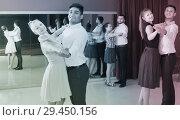 Купить «Glad dancing couples enjoying foxtrot», фото № 29450156, снято 24 мая 2017 г. (c) Яков Филимонов / Фотобанк Лори