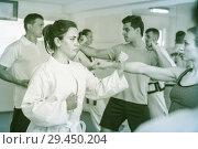 Купить «Men and women learn karate», фото № 29450204, снято 8 апреля 2017 г. (c) Яков Филимонов / Фотобанк Лори