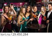 Cheerful colleagues dancing on corporate party. Стоковое фото, фотограф Яков Филимонов / Фотобанк Лори