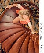 Купить «girl in silk robe stand on wooden spiral staircase», фото № 29450648, снято 26 апреля 2017 г. (c) katalinks / Фотобанк Лори