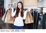 Купить «female purchaser with packs delighted from purchases», фото № 29456116, снято 17 января 2018 г. (c) Яков Филимонов / Фотобанк Лори