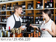 Купить «Happy seller man giving sample taste of wine», фото № 29456220, снято 16 мая 2020 г. (c) Яков Филимонов / Фотобанк Лори