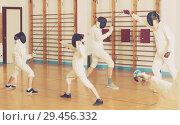 Купить «Mixed group of fencers trains in pairs», фото № 29456332, снято 30 мая 2018 г. (c) Яков Филимонов / Фотобанк Лори