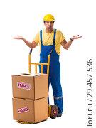Купить «Young contractor with fragile boxes isolated on white», фото № 29457536, снято 6 июля 2018 г. (c) Elnur / Фотобанк Лори