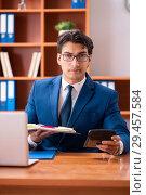 Купить «Young handsome businessman working in the office», фото № 29457584, снято 8 августа 2018 г. (c) Elnur / Фотобанк Лори