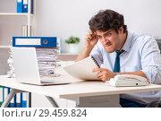Купить «Overloaded busy employee with too much work and paperwork», фото № 29459824, снято 3 июля 2018 г. (c) Elnur / Фотобанк Лори