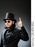 Купить «Vintage concept with man wearing black top hat», фото № 29459852, снято 1 июня 2015 г. (c) Elnur / Фотобанк Лори