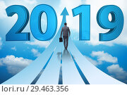 Купить «Businessman running into year of 2019», фото № 29463356, снято 14 августа 2019 г. (c) Elnur / Фотобанк Лори