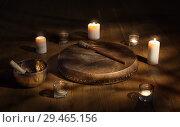 Купить «Shaman tambourine and Tibetan bowl surrounded by candles in a dark room», фото № 29465156, снято 11 ноября 2018 г. (c) Алексей Кузнецов / Фотобанк Лори