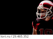 Купить «American football player standing with rugby helmet», фото № 29465352, снято 24 июня 2019 г. (c) Wavebreak Media / Фотобанк Лори