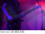 Купить «Electric bass guitar player on a stage», фото № 29465936, снято 11 декабря 2016 г. (c) EugeneSergeev / Фотобанк Лори